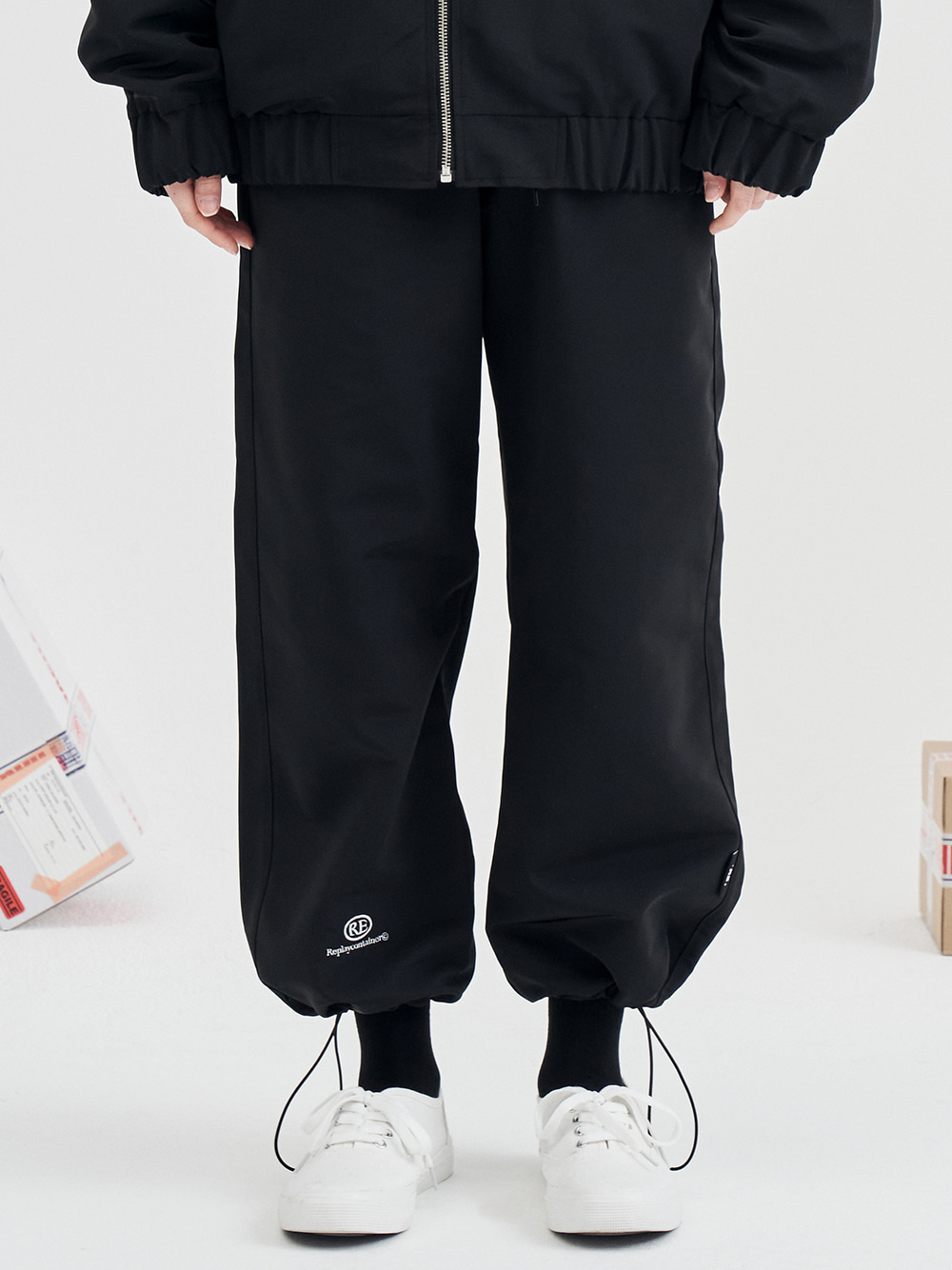 RE capsule logo track string pants (black) [9/28 delivery]